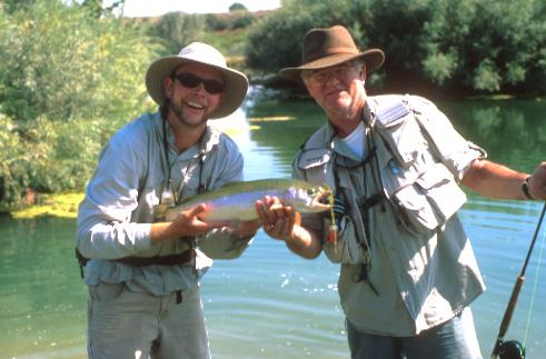 RIGS TWO MEN HOLDING TROUT.jpg