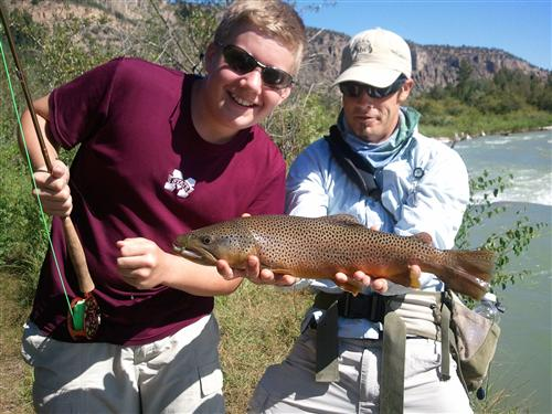 Tyler and Dan RIGS guide with brown trout.jpg